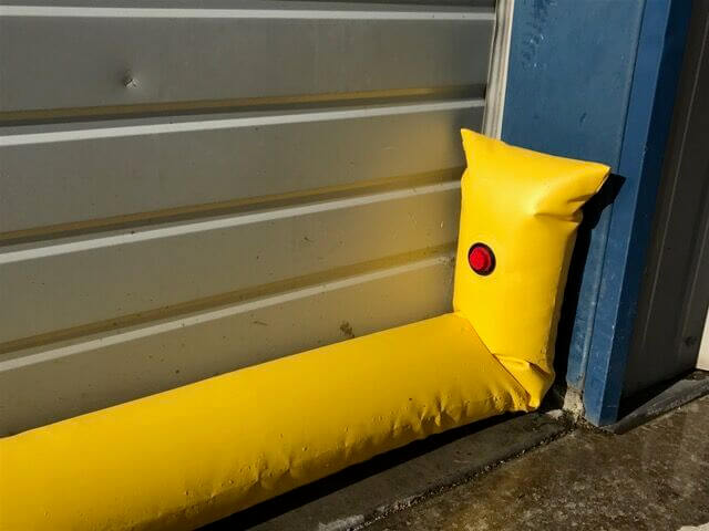 Water Filled Flood Tube to Protect a Door From Flooding